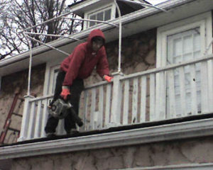 debris removal from the gutters using handheld blowers