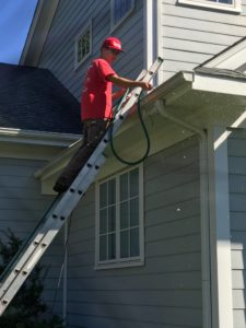 spotless technician cleaning gutters
